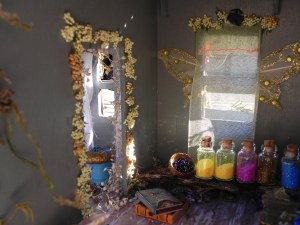 The apothecary, with fairy wings, bark furniture, and bottles of fairy dust...